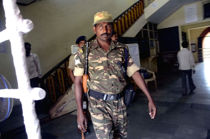 A soldier deployed at D G Ruparel College where counting centre for 2014 Lok Sabha polls has been setup in Mumbai on May 15, 2014.