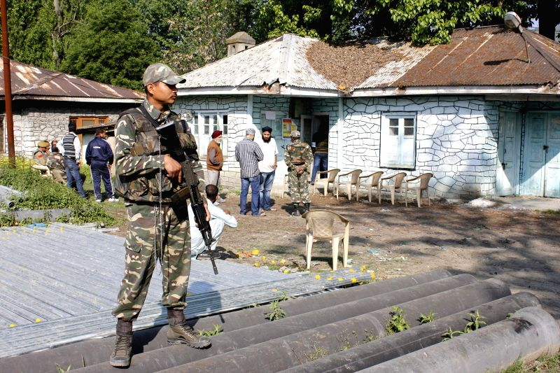 A soldier guards a vacant polling booth as people boycott 2014 Lok Sabha Elections in Sopore of Jammu and Kashmir on May 7, 2014.