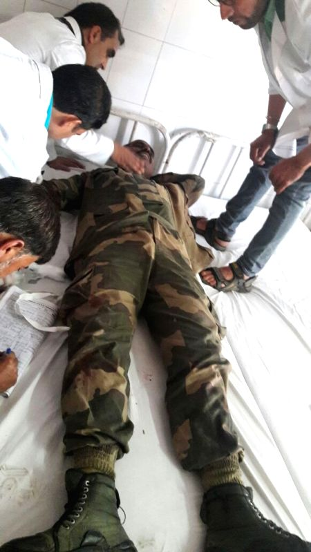 A soldier injured in a Hizb-ul-Mujhadeen attack on BSF convoy on the highway in Bijbehara town of Anantnag district being treated at a hospital on June 3, 2016. Three BSF troopers were ...