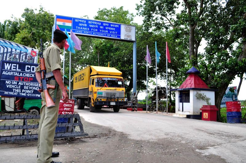 A soldier stands guard as a Bangladeshi truck loaded with rice enters Agartala via Akhaura integrated check post on Aug 7, 2014.