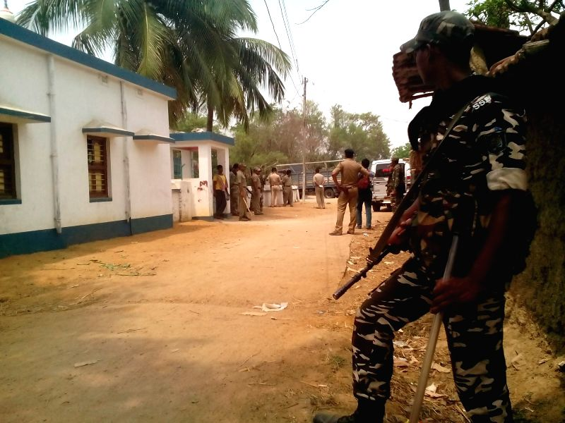 A soldier stands guard at Labhpur of West Bengal's Birbhum district where around six people were injured when activists of Trinamool Congress and the CPI-M, carrying sharp and blunt weapons ...