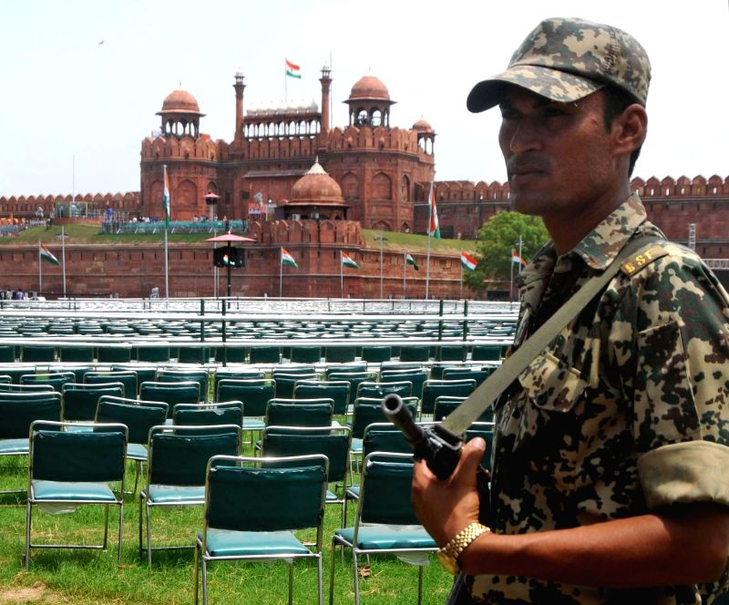 A soldier stands guard at Red Fort on the eve of Independence Day in New Delhi on Aug 14, 2014.