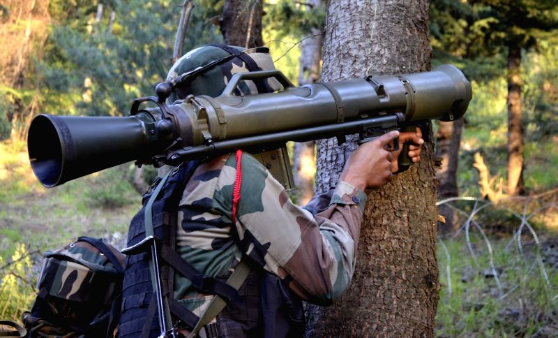 A soldier take position during an encounter with militants in Jammu and Kashmir's Baramulla district on June 9, 2017. Five terrorists killed by the army in Uri sector of the LoC where a ...