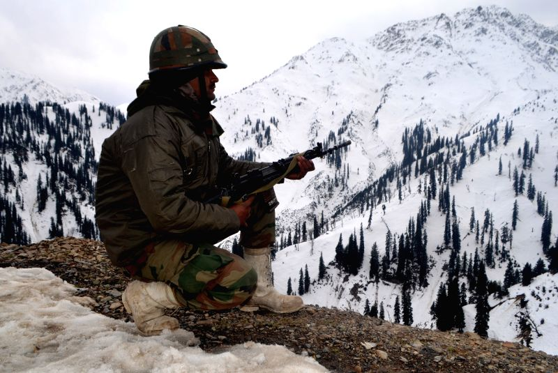 A soldiers takes position in the outer cordon at Tangdhar sector of Kupwara where militants attacked an army camp on Nov 25, 2015.
