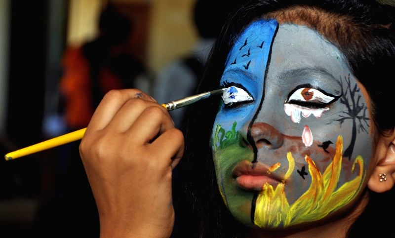 A student gets her face painted during Horlicks Wizkids South Asia final 2014 in Bhubaneswar on Aug 5, 2014. (Photo : IANS)