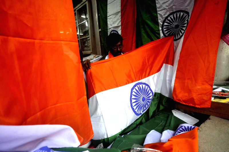 A tailor busy sewing the tricolours ahead of Independence Day in Agartala on Aug 11, 2014.