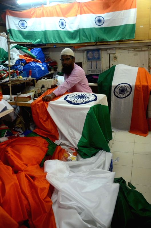 A tailor busy stitching tricolours ahead of Independence Day in Mumbai, on Aug 12, 2017.
