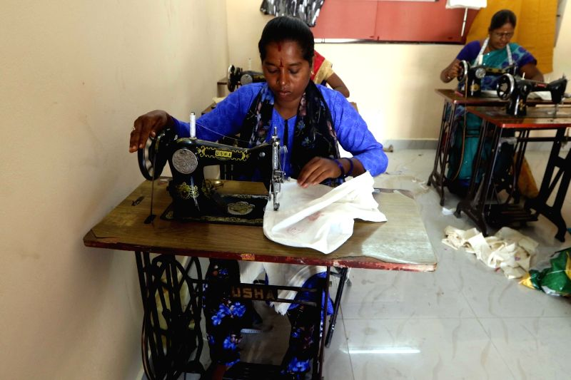 A tailor stitches a biodegradable bag ahead of a plastic ban announced by the Tamil Nadu government, in Chennai on July 16, 2018. The state government recently issued orders that exempted ...