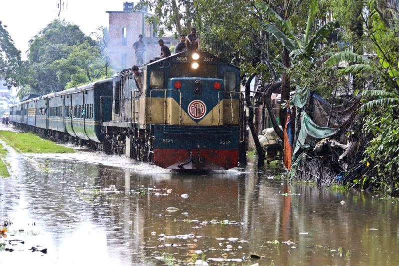 A train struggles through waterlogged tracks at Gandaria Rail Station after heavy rains lashed Dhaka, in Bangladesh on July 23, 2018.