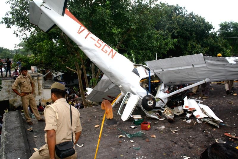 A training aircraft crashes in Kanpur on Sept 3, 2014. A lady pilot was injured in the accident.