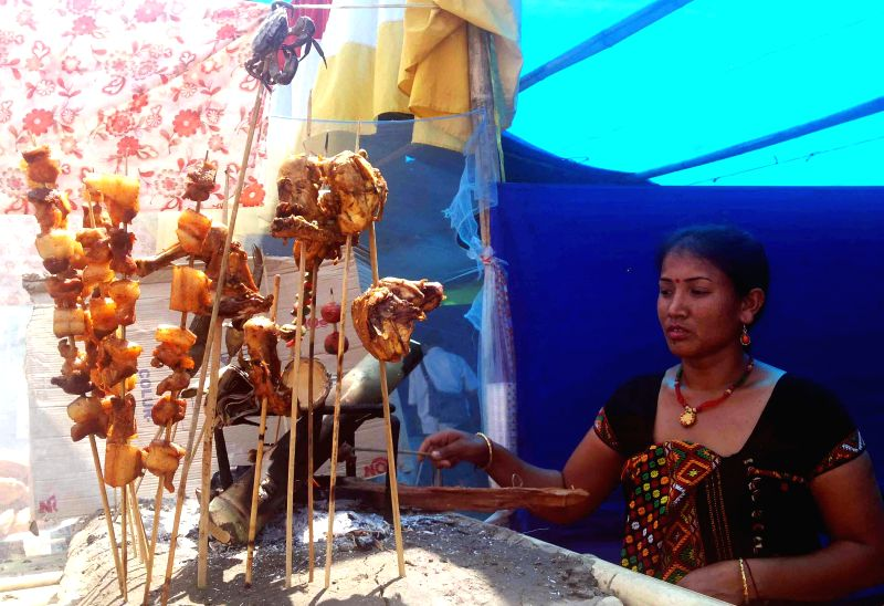 A tribal woman sells ethnic food during the four day long 2nd Baokhungri Festival organised by Bodoland Territorial Council (BTC) Tourism Department at Baokhungri Hill, 10 km away from Kokrajhar on ..