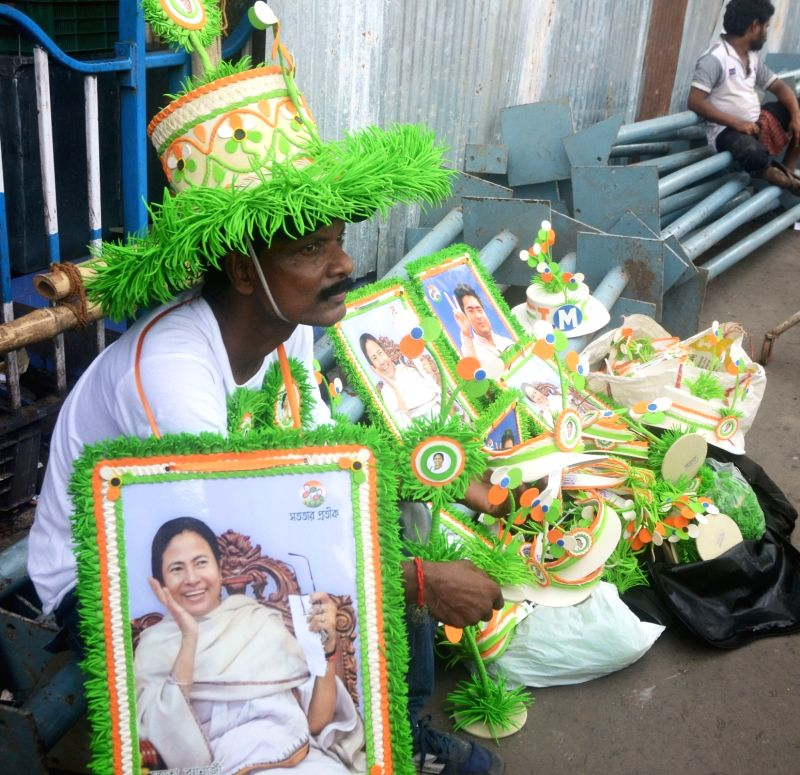 A Trinamool Congress worker oversees preparations for party's Shaheed Diwas in Kolkata on July 18, 2018.