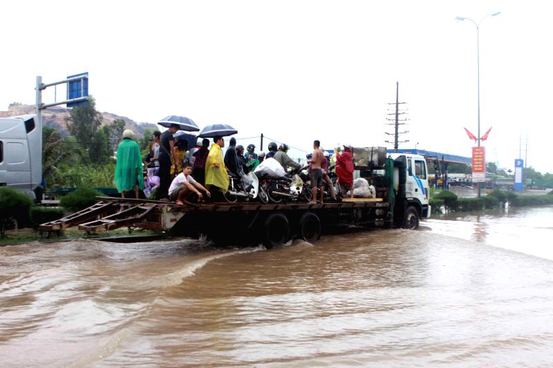 A truck carrying local residents wades through a flooded street in Ha Long city, Quang Ninh province, northeastern Vietnam, July 28, 2015. Floods and landslides ...