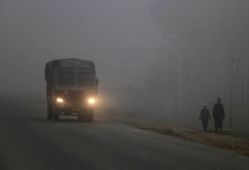 A truck plies on Srinagar-Jammu National Highway amidst dense fog near Pampore on Nov 2, 2015.