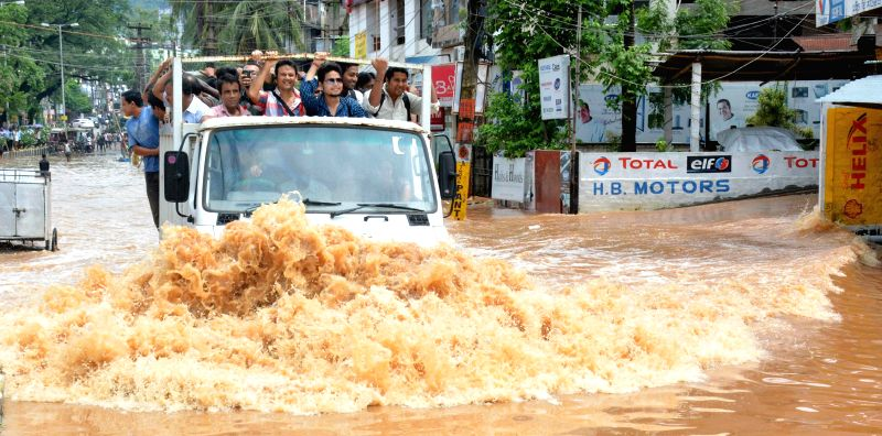 A truck plies on waterlogged Zoo road after heavy showers in Guwahati on June 27, 2014.