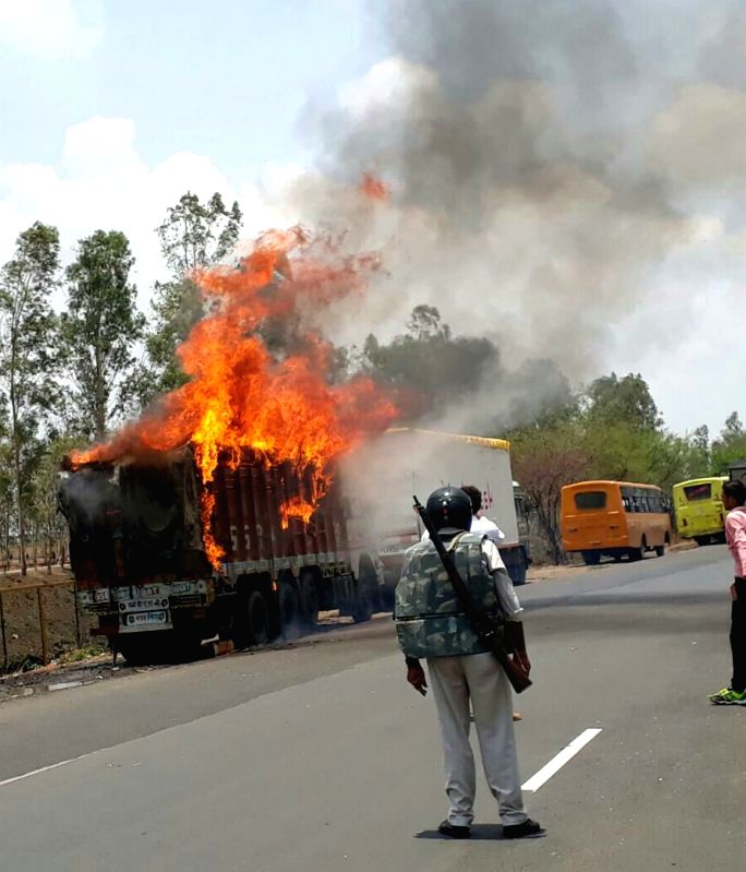 A truck set on fire by protesting farmers in Bhopal on June 9, 2017.