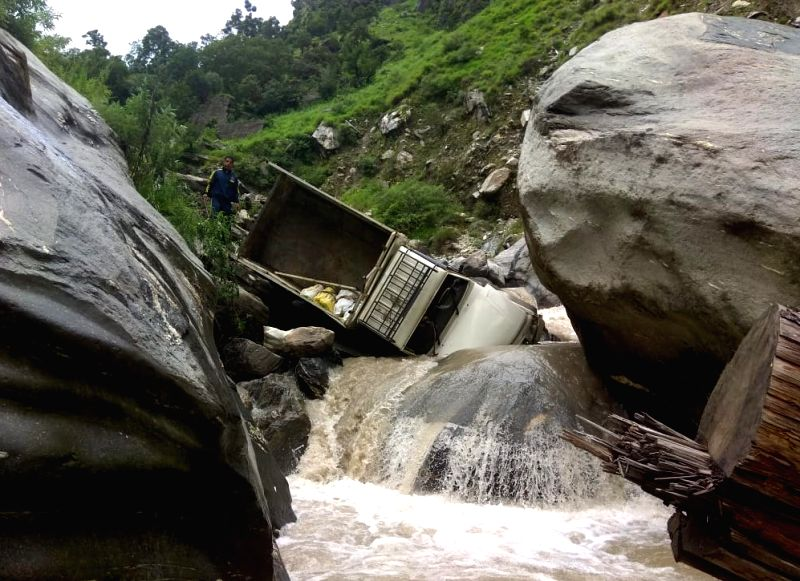 A truck that fell into the Kalp Ganga river in Chamoli district of Uttarakhand on July 26, 2018.