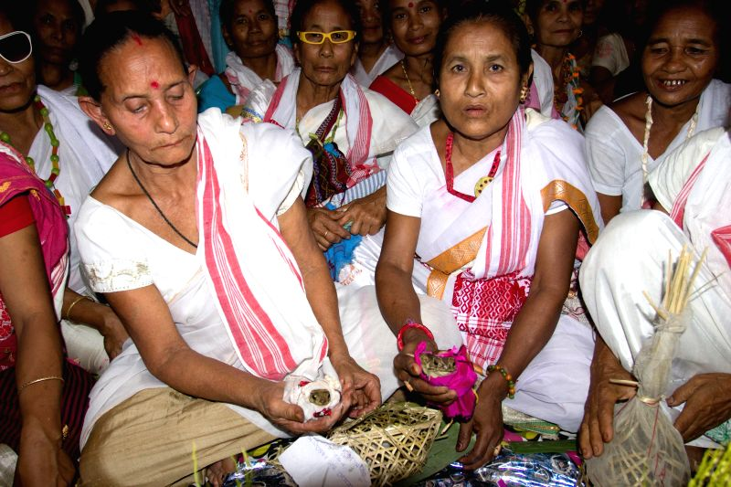 A unique marriage - of frogs underway at Dhekiajan village in Duliajan of Assam on May 4, 2014. Villagers conducted the marriage ceremony of two frogs in traditional manner so as to please the rain ..
