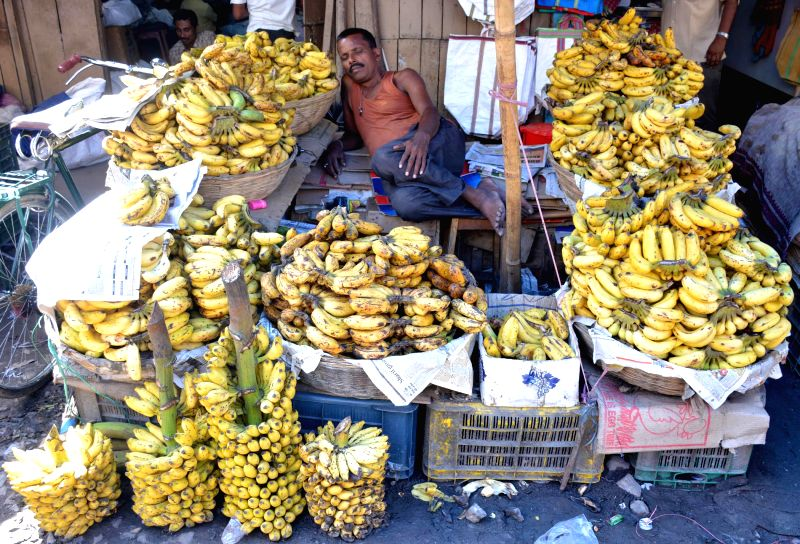 A vendor rest in his banana shop on a hot day at Fancy bazaar area in Guwahati on July 24, 2014.