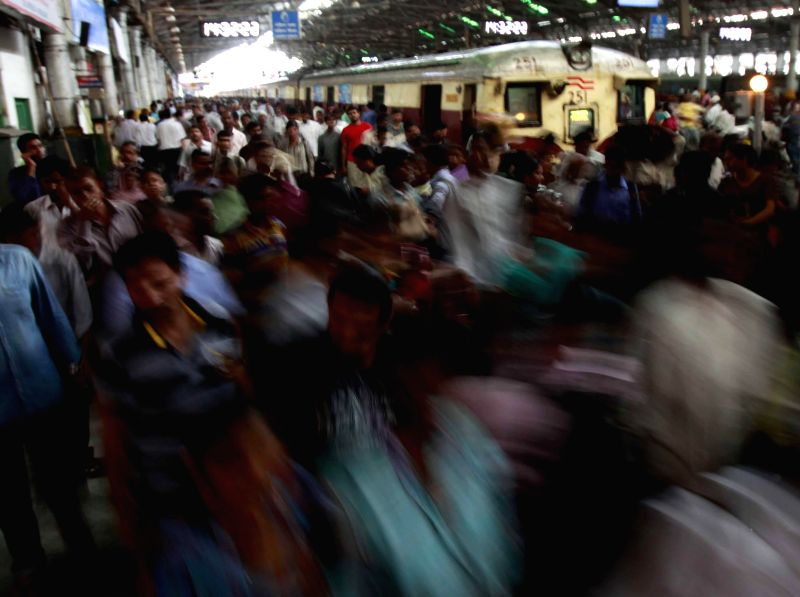 A view of  a bustling Mumbai Railway Station as Union Railway Minister D.V. Sadananda Gowda presents rail budget 2014-15 in the Parliament on July 8, 2014. - D.