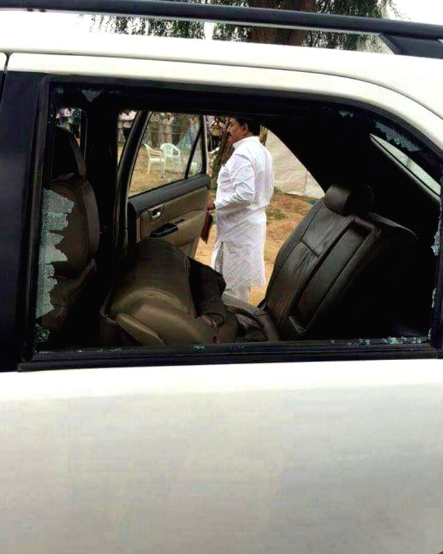 A view of a damaged window panes of the car in which Congress Vice President Rahul Gandhi was on his way to the helipad after meeting flood victims at Runi village in Banaskantha ... - Rahul Gandhi