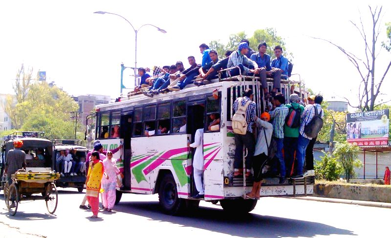 A view of an over-crowded bus in Amritsar on July 11, 2014.