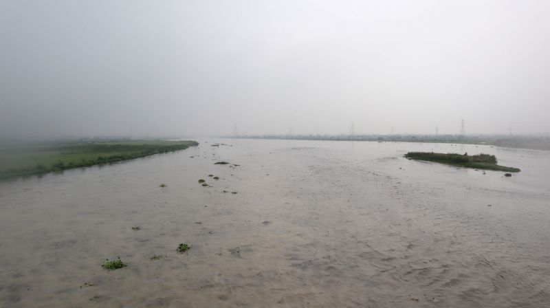 A view of an overflowing Yamuna river, in New Delhi on July 28, 2018. Water released from Haryana's Hathnikund added to the continued rains have led the Yamuna river to breach its ...