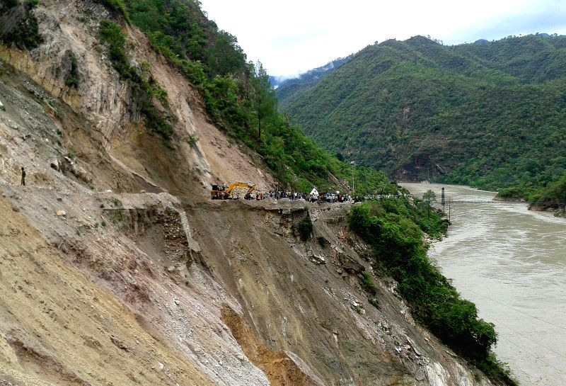 A view of blocked road at Sirobagad in Rudraprayag district of Uttarakhand after landslide on July 19, 2014.