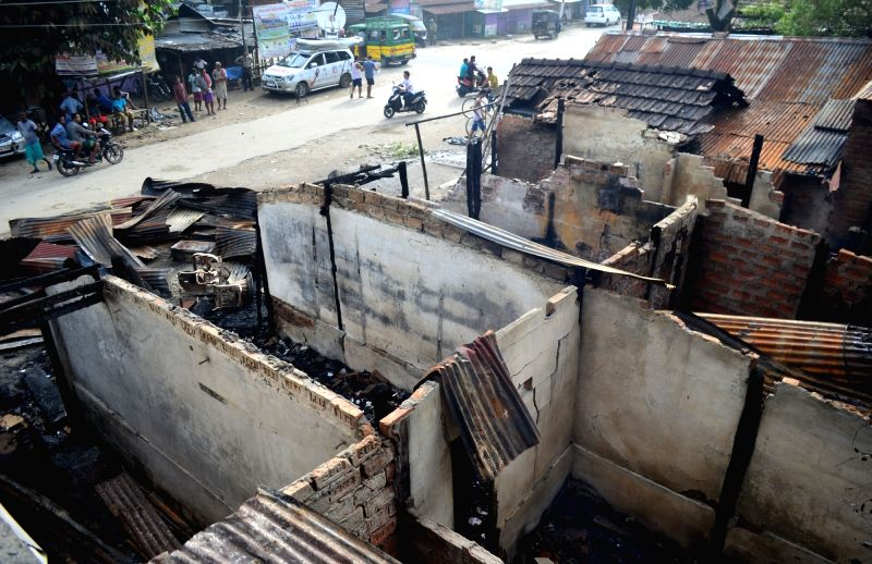 A view of burned shops which was damaged after a gunmen flung grenades during Kokrajhar terror attack at Balajan Tinali in Kokrajhar district of Assam on Aug. 6, 2016. 14 people were ...