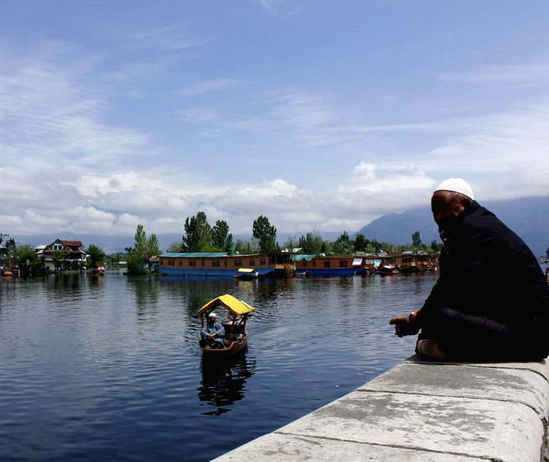 A view of Dal lake after rains in Srinagar on May 13, 2014.