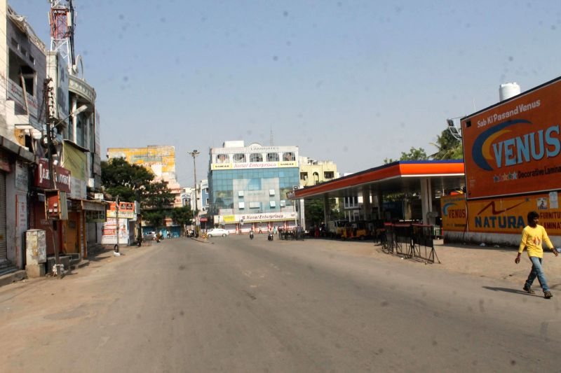 A view of deserted Hyderabad streets as people prefer staying indoors to avoid the heat, on May 11, 2014.