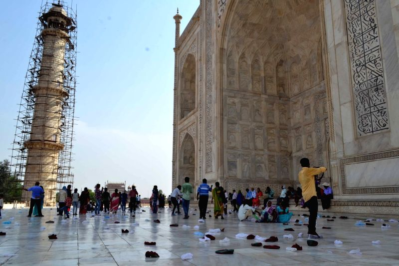 A view of disposable shoe covers which was abandoned by visitors at the Taj Mahal in Agra on May 21, 2016.