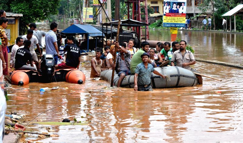 A view of flood hit Anil Nagar area of Guwahati after heavy showers on June 27, 2014.