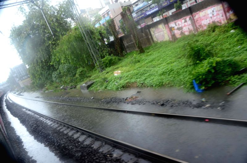 A view of flooded railway tracks after rains lashed Mumbai on June 9, 2018.