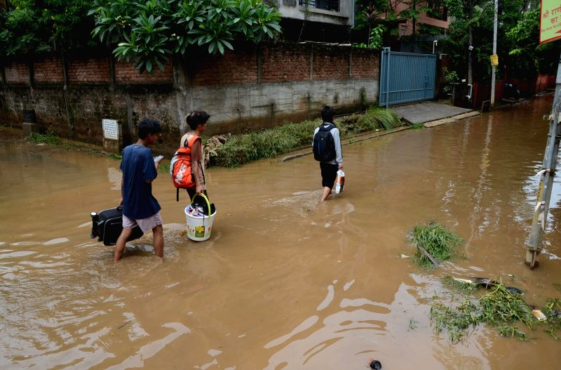 A view of flooded streets of Guwahati on June 14, 2017.The people of the Guwahati city had to struggle with the floods for the second day on Wednesday as many houses remained submerged till ...