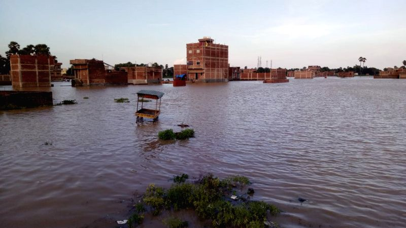 A view of houses submerged in flood hit areas of Nalanda district of Bihar, on Aug 8, 2018.
