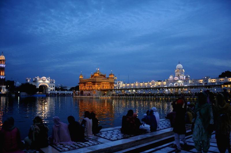 A view of illuminated Golden Temple on the eve of Baisakhi in Amritsar, on April 13, 2018.