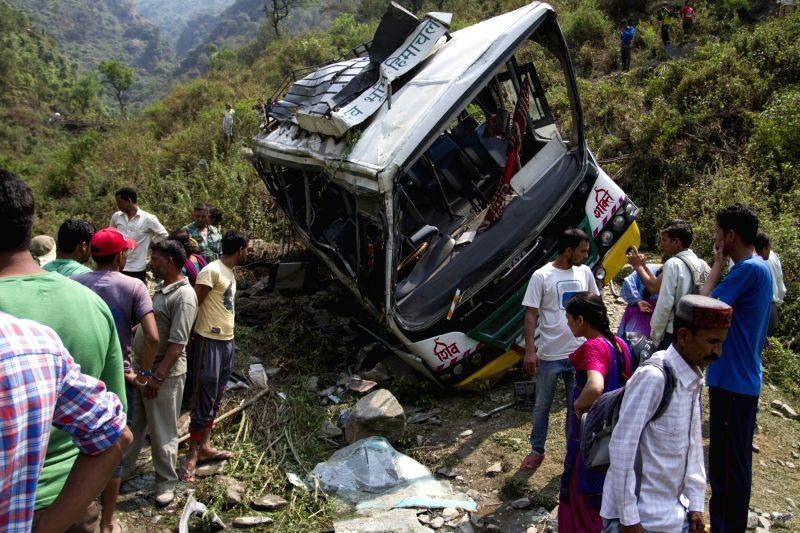 A view of mangled remains of the bus that fell into a gorge near Jogindernagar killing 14 people and injuring 40 others on May 8, 2016.