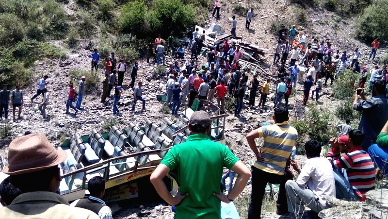 A view of mangled remains of the bus that fell into a gorge at Bijouri Pool near Shimla killing 11 people and injuring 25 others on May 21, 2016.