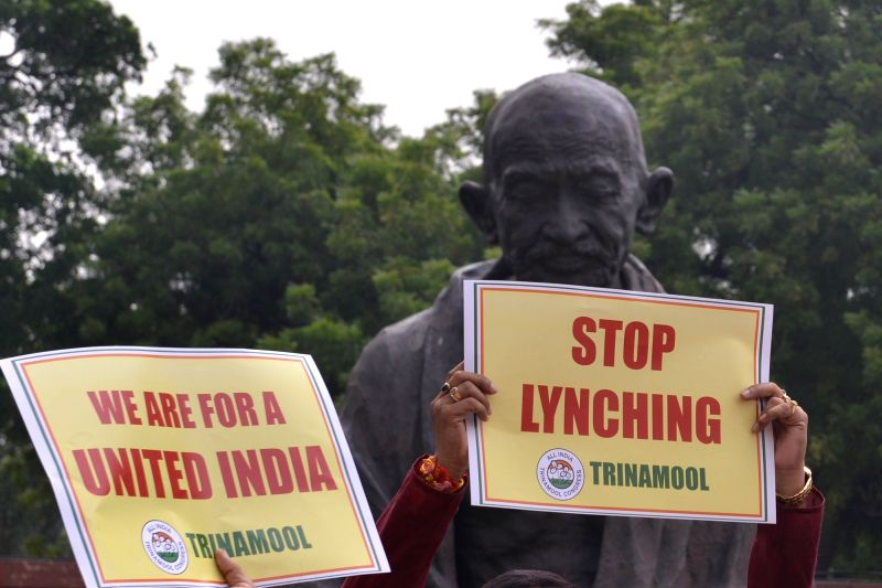 A view of placards raised by TMC MPs during a demonstration against the incidents of lynching in front of the Gandhi statue at Parliament, in New Delhi on July 24, 2018.