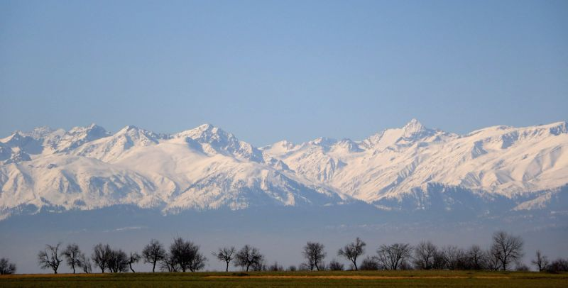 Kashmir in photos: A view of snow covered Gulmarg range as seen from Pampore of Jammu and Kashmir.