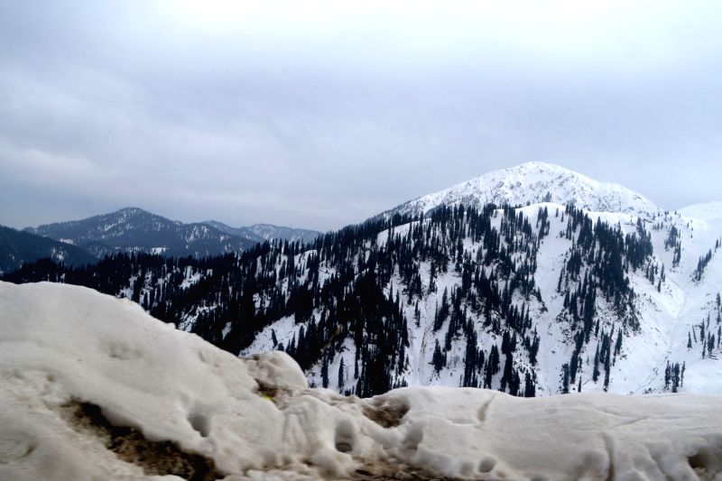 A view of snow covered mountains at Tangdhar in Jammu and Kashmir`s Kupwara district on Nov 25, 2015.
