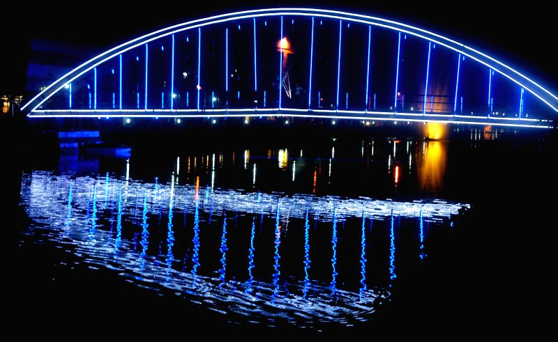 A view of spectacularly illuminated bridge on Nayanjuly canal in Kolkata on July 18, 2014.