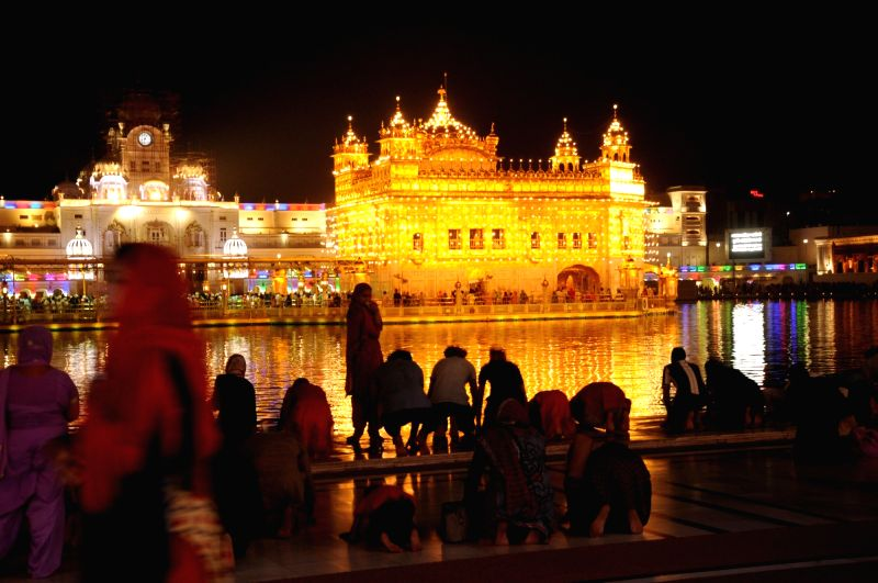 A view of spectacularly illuminated Golden Temple on  'Gurta Gadhi Diwas' of sixth Sikh master, Guru Hargobind in Amritsar, on June 7, 2018.