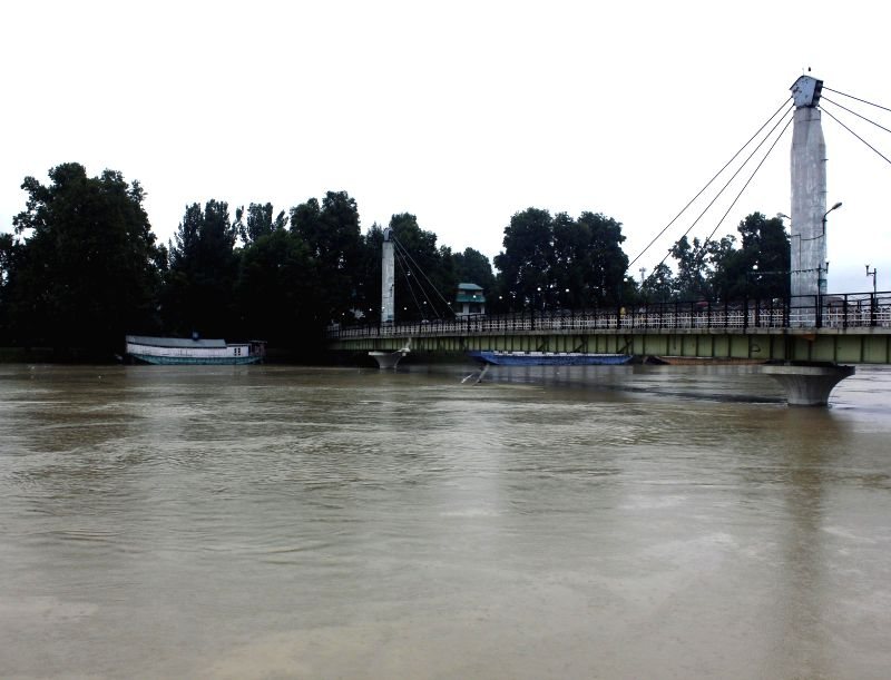 A view of swollen Jhelum river in Srinagar on Sept 4, 2014. A flood alert has been sounded in the city.