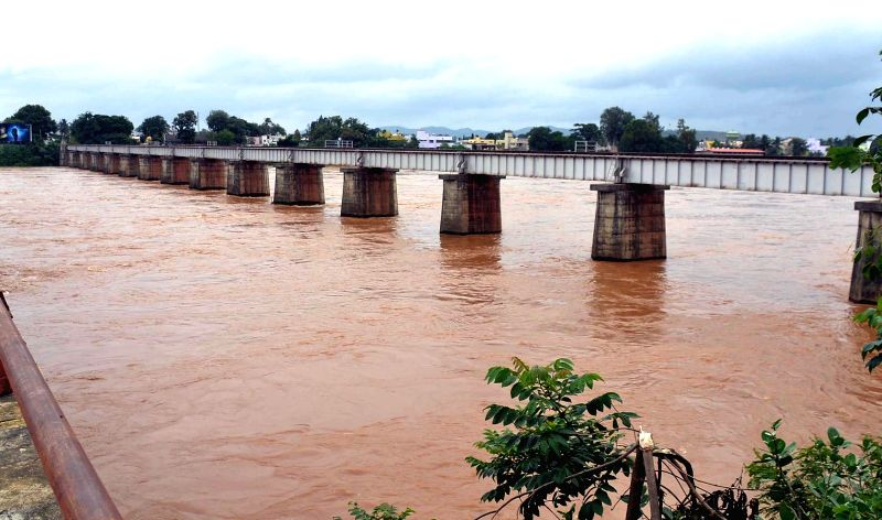 A view of swollen Tunga river after heavy rains in Shimoga of Karnataka on July 18, 2014.