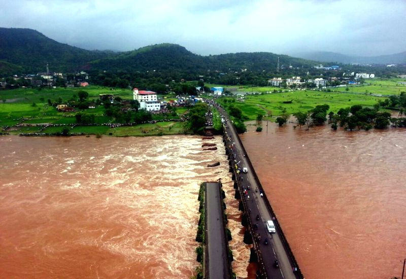 A view of the bridge on Mumbai-Goa Highway, a portion of which collapsed on Aug 3, 2016.  At least two buses with about 22 passengers were washed away in flood waters in Raigad of Maharashtra.