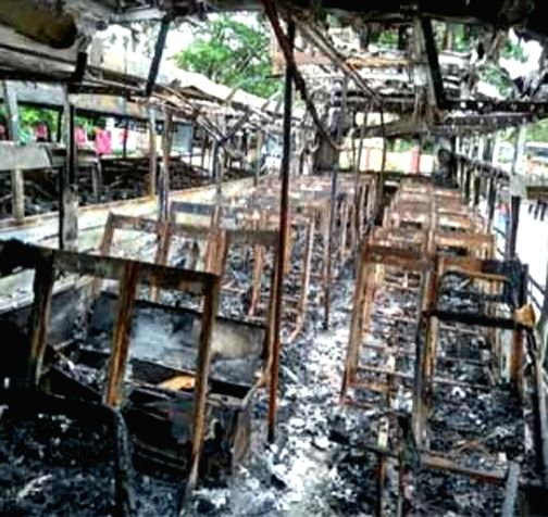 A view of the charred buses after they caught fire reportedly due to a short circuit at RTC bus depot, in Telangana's Warangal on Aug 2, 2018.