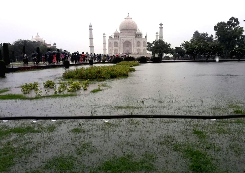 A view of the flooded lawns at the Taj Mahal after heavy rains lashed Agra on July 26, 2018.