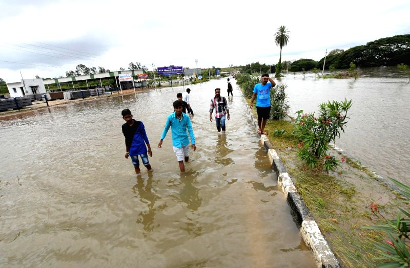 A view of the flooded NH 766 near Mallanna Mobile got submerged following heavy outflow from the Kapila Reservoir; in Mysuru on Aug 10, 2018.